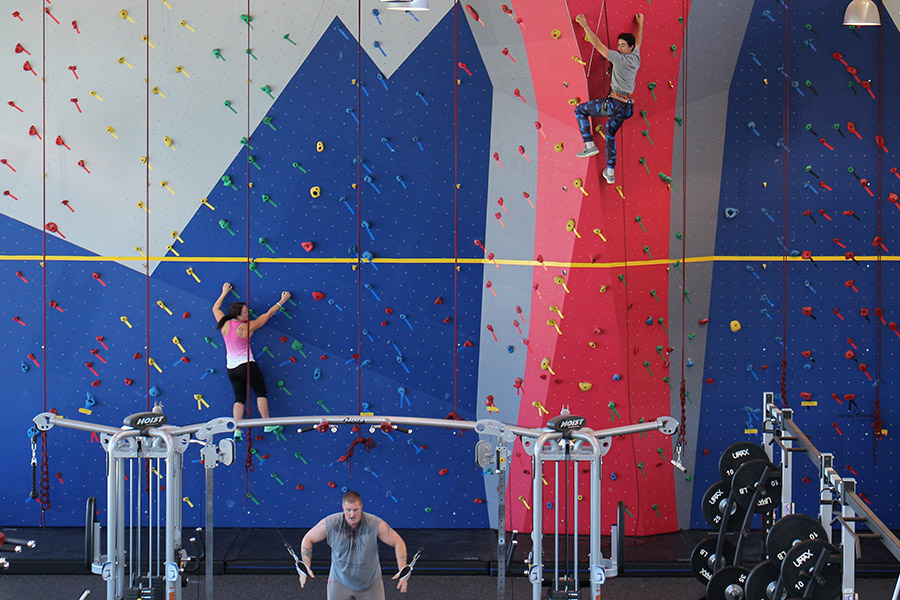 Image of students using rock climbing wall
